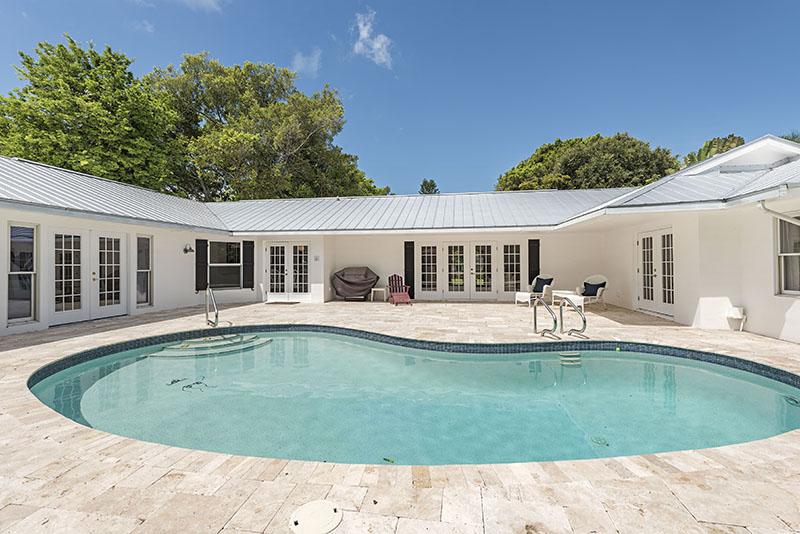 pool in backyard of home