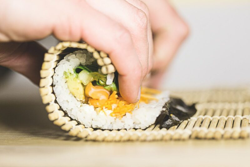Sushi chef rolling a new sushi roll in Naples Florida