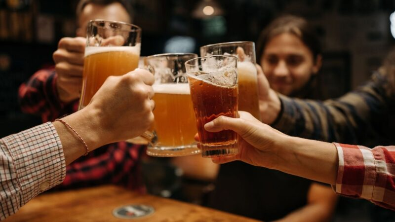 group cheers at a brewery